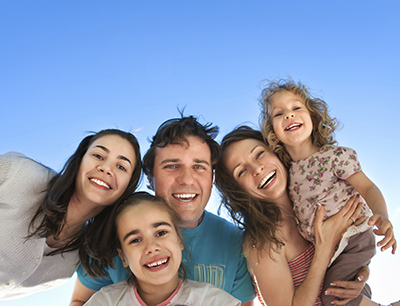 Family smiling about the dental services they received at Martin Periodontics in Mason, OH